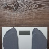 Electronic scales on the wooden floor — Stock Photo