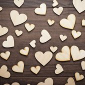 Wooden heart shapes on the table — Stock Photo