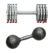 A dumbbell under the light background  — Stock Photo