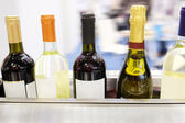 Wine bottles on a counter — Stock Photo