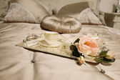 Tray with cup and rose — Stock Photo