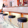 Chairs in row in bar — Stock Photo #63342299