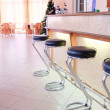 Chairs in row in bar — Stock Photo #63342303