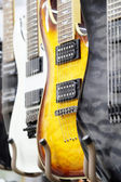 Many electric guitars — Stock Photo