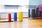 Colored barbel weights in gym — Stock Photo