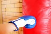 Boxing glove punch punching bag — Stock Photo