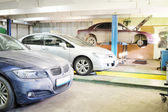 Cars in garage prepared for repair — Stock Photo