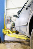 Details of lift in a car care garage — Stock Photo
