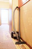 Vacuum cleaner in corridor — Stock Photo