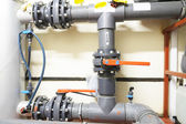 Plastic pipes and valves — Stock Photo