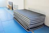 Gymnastics mats in sports hall — Stock Photo