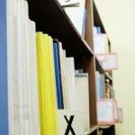 Books in a row on bookshelf — Stock Photo #69770953