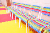 Colorful chairs in row — Stock Photo