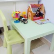 Children's table with toys — Stock Photo #70746061