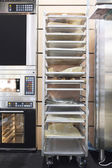 Metal rack for fresh bread — Stock Photo
