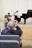 Spectators watch  musical concert — Stock Photo