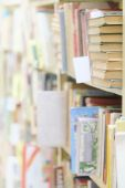 Books on the shelf in  library — Stock Photo