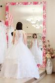 Woman tries on  wedding dress — Stock Photo