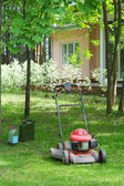 Lawn mower in the garden — Stock Photo