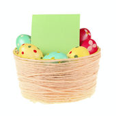Basket of colorful Easter eggs — Stock Photo
