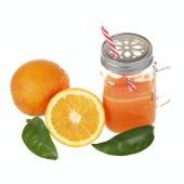 Orange juice in a mason jar glass — Stock Photo
