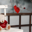 Valentine decorations. Teddy bear with red knitted heart — Stock Photo #64947813