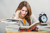 Girl student with glasses reading books — Stock Photo