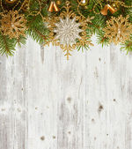 Christmas decoration on old grunge wooden board — Zdjęcie stockowe