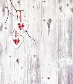 Two hearts, hanging on a branch — Stock Photo