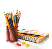School equipment with pencils, notebook,  paints and brushes — Stock fotografie