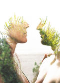 Couple combined with greenery — Stock Photo