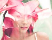 Woman combined with flowers — Stock Photo