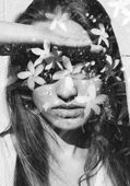 Girl combined with flowers — Stock Photo
