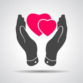Two pink hearts icon in careful hands — Stock Vector