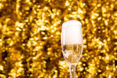 Champagne glass on christmas background — Stock Photo