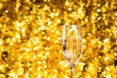 Champagne glass on christmas background — Zdjęcie stockowe