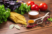 Pasta, vegetables, basil, spices, salt and spoons — Stock Photo