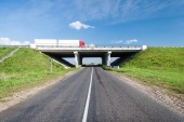 Bridge over the rural road — Stock Photo