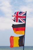 Flags on flagpole — Stock Photo