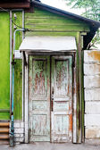 Wooden door in old house wall. — Stock Photo