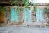 Three windows of a old wooden house in Russia — Stock Photo