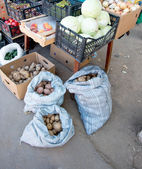 Potatoes in bags, fruit and vegetables stall in Russia — Stock Photo