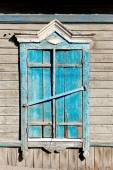 Aged wood window painted in blue colour — Stock Photo