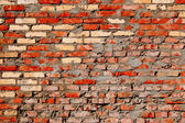 Red obsolete brick wall background — Stock Photo