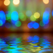 Street lights bokeh background reflection in water — Stock Photo
