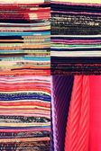 Stack of colorful fabric. Set of vertical images — Stockfoto