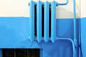Old vintage iron heater radiator painted in blue lot of copyspace — Stock Photo