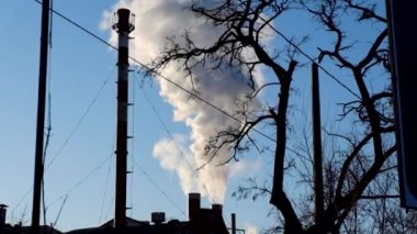 Pollution, smoke and steam discharged from an industrial facility. — Stock Video