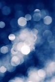 Blue defocused lights water drops blurred background — Stock Photo