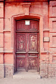 Old brown door in Astrakhan, Russia. — Stock Photo